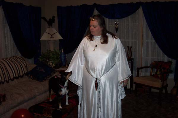 WinterSky in priestess robe communing with her dog